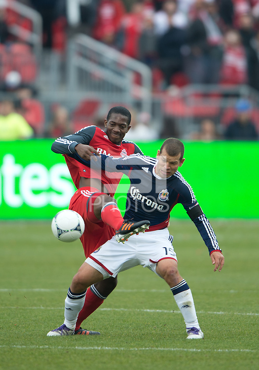14 April 2012: Toronto FC defender Doneil Henry #4 and Chivas USA forward Alejandro Moreno #15 in action during the second half in a game between Chivas USA and Toronto FC at BMO Field in Toronto..Chivas USA won 1-0.