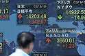 September 9th, 2013 : Tokyo, Japan - A man looked at a stock quotation board at Yaesu, Chuo, Tokyo, Japan on September 9, 2013. Nikkei Stock Average climbed due to several reasons, such as Tokyo that was selected to host the 2020 Olympics and Paralympics.  (Photo by Koichiro Suzuki/AFLO)