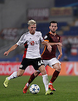 Calcio, Champions League, Gruppo E: Roma vs Bayer Leverkusen. Roma, stadio Olimpico, 4 novembre 2015.<br /> Bayer Leverkusen's Kevin Kampl, left, is challenged by Roma's Miralem Pjanic during a Champions League, Group E football match between Roma and Bayer Leverkusen, at Rome's Olympic stadium, 4 November 2015.<br /> UPDATE IMAGES PRESS/Isabella Bonotto