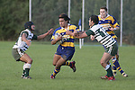 NZ U19 player Male Sa'u tries to break through between 2 manurewa defenders. Counties Manukau Premier Club Rugby, Patumahoe vs Manurewa played at Patumahoe on Saturday 6th May 2006. Patumahoe won 20 - 5.