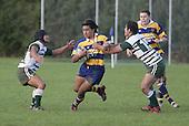 NZ U19 player Male Sa'u tries to break through between 2 manurewa defenders. Counties Manukau Premier Club Rugby, Patumahoe vs Manurewa played at Patumahoe on Saturday 6th May 2006. Patumahoe won 20 - 5.