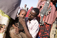 Kenya - Dadaab - 22nd July 2011. Ibrahim Isaac, 35 years old, comes from Bardhere, in the Gedo region. Her wife died some months ago for natural causes, leaving him to look after his 4 year old daughter Adey alone. He has been a farmer since he was 15, but after the drought and his move to Dagahaley refugee camp he plans to change activity and settle in Kenya, rather than going back to Somalia.