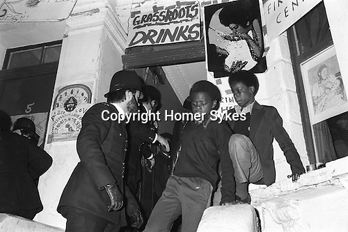 Police raid private house  All Saints Road during the Notting Hill Carnival London UK 1979.