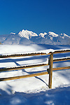 A wood rail fence on a clear winter day in the Mission Valley of western Montana