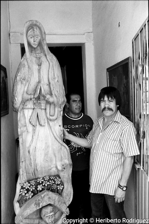 Archive photo of Mexican boxer Ruben Olivares, best known as El Puas, poses with a Virgin of Guadalupe at the entrance of his workshop in Mexico City historical center, June 19, 1992..  © Photo by Heriberto Rodriguez
