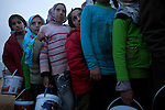 Girls wait in line to collect dinner for their families at Azaz Camp, just inside the Syrian border with Turkey, Feb. 25, 2013. According to administrators, this camp holds roughly 9,000 to 10,000 internally displaced persons (IDP's). Two meals per day are provided by a Turkish humanitarian organization, and Qatar Red Crescent provided tents. There is very little electricity, and no running water. There is also a refugee camp on the Turkish side of the border, but it is full. The UN Refugee Agency has reported a sharp increase in refugees fleeing Syria for neighboring countries in the first months of 2013.