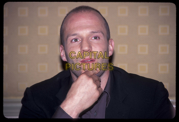 JASON STATHAM.Ref: ND.portrait, headshot, touching chin.*RAW SCAN- photo will be adjusted for publication*.www.capitalpictures.com.sales@capitalpictures.com.©Capital Pictures
