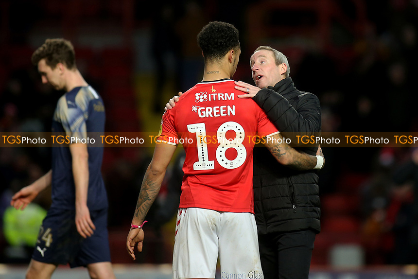 Charlton Athletic Manager, Lee Bowyer, hugs Andre Green at the final whistle who scored their second goal during Charlton Athletic vs Barnsley, Sky Bet EFL Championship Football at The Valley on 1st February 2020