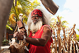 MAURITIUS, a local woodcarver works on a carving by the waterfront in Port Louis