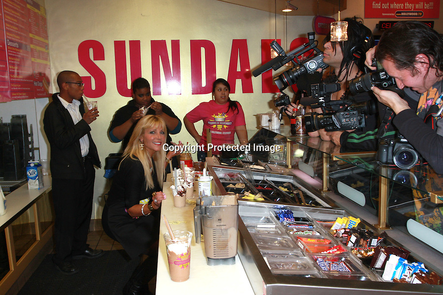 """Pamela Bach-Hasselhoff launched her shake at Millions of Milkshakes....1-3-2010  ....(Hollywood,CA) Jan 3rd 2010. Actress Pamela Bach-Hasselhoff launched her own Milkshake in style at famous celeb hotspot Millions of Milkshakes Sunday night. This was indeed a night to remember as the Former Baywatch star and Ex wife to David Hasselhoff arrived with 5 of her foster kids from Hollywood's Covenant House that helps restore hope in unfortunate kids. ..It was a media Frenzy as always as fans and photogs among others stormed the West Hollywood hotspot previously visited by the likes of Lindsay Lohan, Miley Cyrus, the Kardashians, Donny Osmond and many more. ..Pamela wanted to start the new year with a positive note and thus named her signature shake: ..""""THE NEW VISION SHAKE"""" that has the following contents: Peanut Butter, Chocolate Syrup, Vanilla Low Fat Yogurt, Almonds, Kiwi, Bananas, Whipped Cream with a Cherry on Top! ..Lets stay tuned for the next chapter as you never know who might show up next at Millions of Milkshakes. Celebrities just can't seem to get away from this spot.....Abilityfilms@yahoo.com.805-427-3519.www.AbilityFilms.com."""