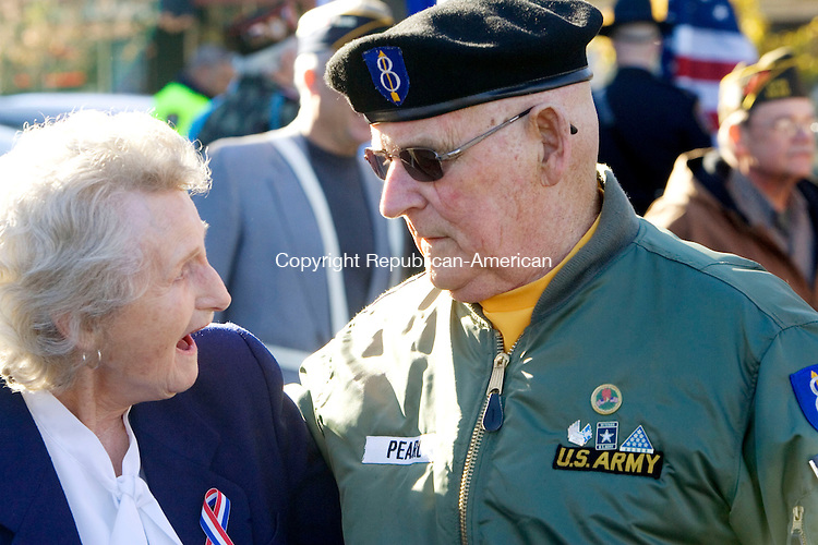 NAUGATUCK, CT. 11 November 2010-111110SV12--From left, Dorothy Knowles and Larry Pearl, commander of Post 17 of the American Legion, march in the Veterans Day parade in Naugatuck Thursday.<br /> Steven Valenti Republican-American