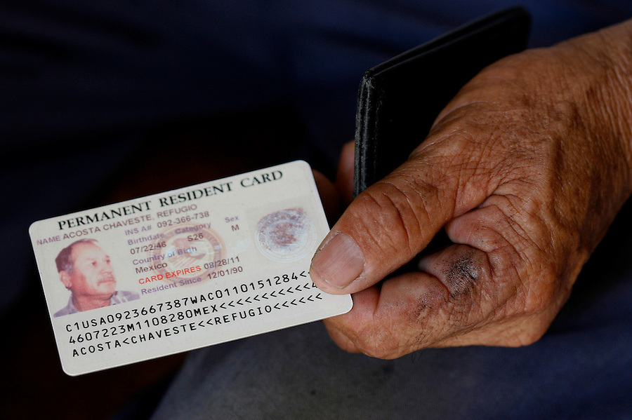 Mecca for Misery.Refugio Acosta Chaveste, 59, of Mexico, shows his permanent resident card. Refugio rents room in an illegal trailer in Mecca during the grape harvest.