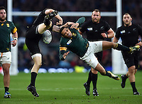 Bryan Habana of South Africa competes with Ben Smith for the ball in the air. Rugby World Cup Semi Final between South Africa and New Zealand on October 24, 2015 at Twickenham Stadium in London, England. Photo by: Patrick Khachfe / Onside Images