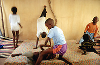 Mali. Bamako. Muslim children play at home on mattresses laid on the floor. © 1997 Didier Ruef