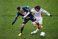 Michael Farfan (21) of the Philadelphia Union fights for the ball with Juan Carlos Toja (7) of the New England Revolution during the game at PPL Park in Chester, PA.  The Philadelphia Union defeated the New England Revolution, 1-0.
