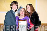 MERIT: Aki O'Rourke shows his Mother and sister his kerry Garda Merit Certificate which he got on Friday night at the Kerry Garda Youth Acheivement Awards, in the Brandon Hotel, Tralee..........