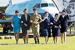 National Museum of Flight Wheels and Wings event. BA Flight attendant fashion show.<br /> <br /> Pictured (L-R): Johana Anderson wearing a BOAC 1970's uniform; Anita Briggs wearing a BEA late 1940's uniform, Tristan Wytes wearing a 1930's Imperial Airways pilot uniform; Alyson Orme in a BEA, Hardie Armis design, 1970's uniform; Ali Rae in  a BOAC late 1940's uniform; and Nicki Brae in an early 1960's BEA uniform. <br /> <br /> Image by: Malcolm McCurrach