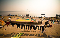 Laundryman  drying clothes on the bank of River Ganga in Varanasi.<br /> (Photo by Matt Considine - Images of Asia Collection)