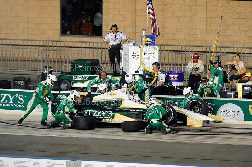 Ed Carpenter (#20) makes a pit stop.