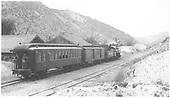 K-28 #473 with the southbound Santa Fe passenger train making the stop at Embudo.<br /> D&amp;RGW  Embudo, NM  Taken by Richardson, Robert W. - 7/2/1941