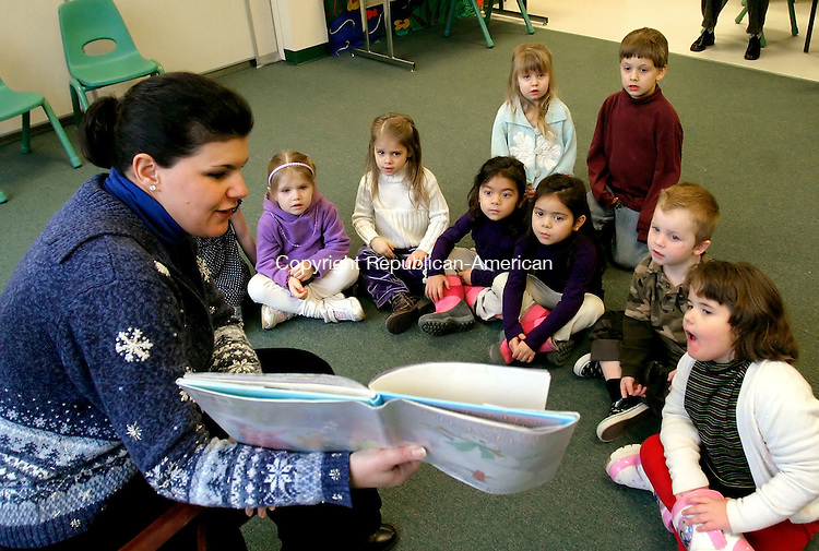 MIDDLEBURY, CT- 15 JANUARY 2008-011508JS07--Jo-Ann LoRusso, childrens library assistant at the Middlebury Public Library, reads the book 'The Biggest, Best Snowman by Margery Cuyler during stroytime for 3-5 year olds Wednesday at the library. The library board of directors have asked the town for $29,000 to hire one full time and one part-time employee to they can re-open on Saturday's and Wednesday nights.<br /> eveningJim Shannon / Republican-American