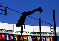 Silhouette of a man pole vaulting