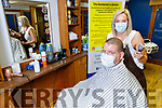Sharon Lawson and her husband Alan Core demonstrating the new social guidelines when Hairdressers/Salon reopen at her Gentlemans Barber shop in Listowel on Friday.