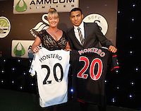 Pictured: Jefferson Montero with sponsor Wednesday 20 May 2015<br /> Re: Swansea City FC Awards Dinner at the Liberty Stadium, south Wales, UK