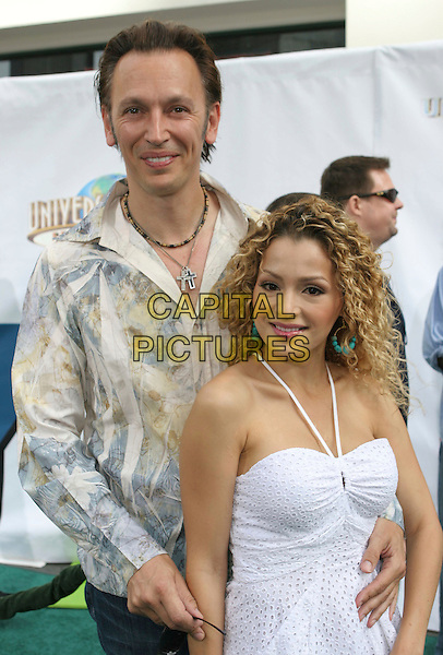 STEVE VALENTINE & SYLVIA DeMARCO.Evan Almighty Premiere held at the  Gibson Amphitheatre & Citywalk Cinemas, Universal City, California, USA..June 10th, 2007.half length dress white halterneck arm around waist blue yellow pattern shirt .CAP/ADM/CH.©Charles Harris/AdMedia/Capital Pictures