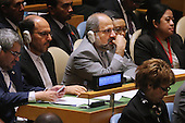 Iranian Minister of Foreign Affairs Mohammad Javad Zarif Khonsari (C) and members of his delegation listen as United States President Barack Obama addresses the 70th annual United Nations General Assembly at the UN headquarters September 28, 2015 in New York City. Obama will hold bilateral meetings with Indian Prime Minister Narendra Modi and Russian President Vladimir Putin later in the day. <br /> Credit: Chip Somodevilla / Pool via CNP