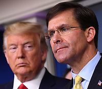 United States Secretary of Defense Dr. Mark T. Esper delivers remarks on the COVID-19 (Coronavirus) pandemic as US President Donald J. Trump looks on in the Brady Press Briefing Room at the White House in Washington, DC on Wednesday, March 18, 2020. <br /> Credit: Kevin Dietsch / Pool via CNP/AdMedia
