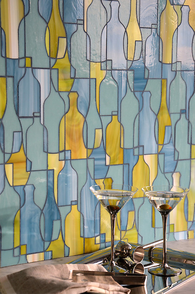 Bottles, a waterjet glass mosaic shown in Peridot, Serpentine, and Mica, is part of the Erin Adams Collection for New Ravenna.