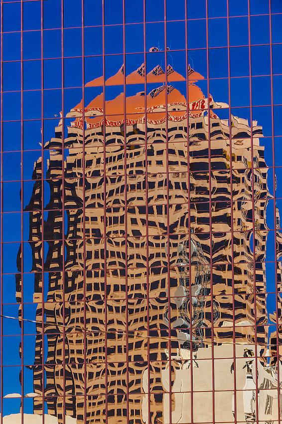 Reflection on a glass building of the Bank of Albuquerque Tower building, Downtown Albuquerque, New Mexico USA.