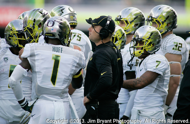 Oregon Ducks head coach Mark Helfrich huddles his offensive in a college football game at Husky Stadium in Seattle, Washington on October 12, 2013. The Oregon Ducks beat the Washington Huskies 45-24.  © 2013. Jim Bryant Photo. All Rights Reserved.