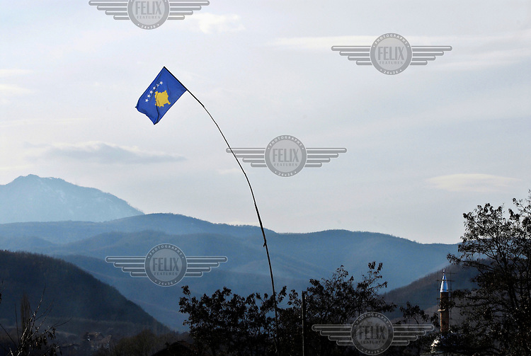 The new Kosovo flag flies in the village of Chabra, the last Albanian village before the Serb controlled northern part of Kosovo..