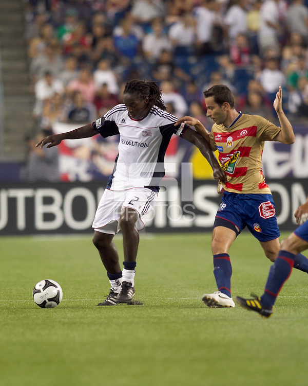 New England Revolution midfielder Shalrie Joseph (21) dribbles as Monarcas Morelia forward Luis Gabriel Rey (18) defends. Monarcas Morelia defeated the New England Revolution, 2-1, in the SuperLiga 2010 Final at Gillette Stadium on September 1, 2010.