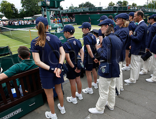 04.07.2016. All England Lawn Tennis and Croquet Club, London, England. The Wimbledon Tennis Championships Day 8. Ball boys and girls wait with line judges to go onto an outside court today.