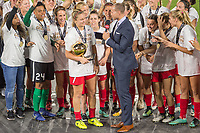 Orlando, FL - Saturday October 14, 2017: Lindsey Horan celebrates winning the mvp of the match during the NWSL Championship match between the North Carolina Courage and the Portland Thorns FC at Orlando City Stadium.