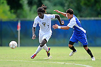 2 October 2011:  FIU defender Jahbari Willis (7) and Kentucky defender Charlie Pettys (21) pursue a loose ball in the first half as the FIU Golden Panthers defeated the University of Kentucky Wildcats, 1-0 in overtime, at University Park Stadium in Miami, Florida.