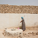 Morocco - Tidzi - Amina Hammoush, 40, washes her hands in the courtyard of her house after having prepared the argan oil.