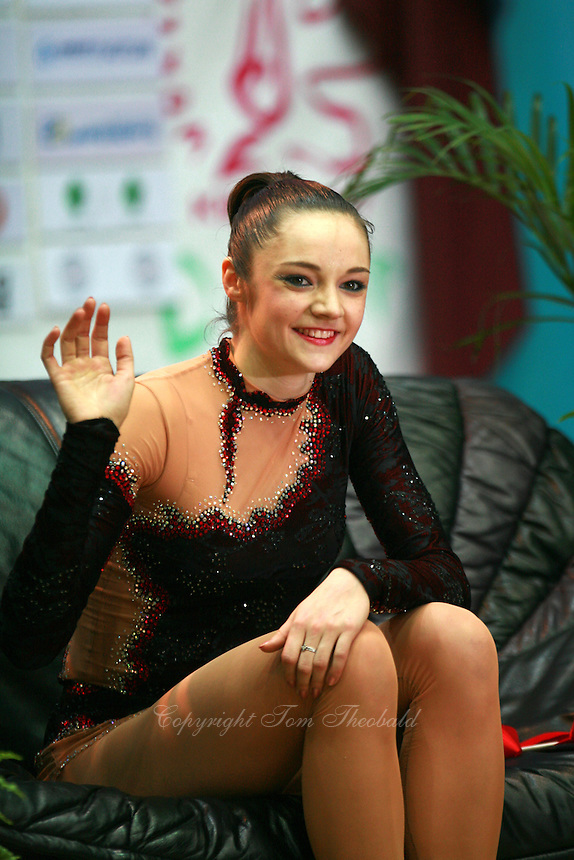 """Anna Bessonova of Ukraine waves to fans from """"kiss & cry"""" during All-Around at 2007 World Cup Kiev, """"Deriugina Cup"""" in Kiev, Ukraine on March 17, 2007. Anna won the seniors All-Around."""