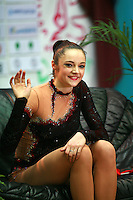 "Anna Bessonova of Ukraine waves to fans from ""kiss & cry"" during All-Around at 2007 World Cup Kiev, ""Deriugina Cup"" in Kiev, Ukraine on March 17, 2007. Anna won the seniors All-Around."