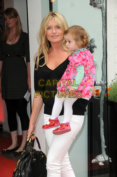 TINA HOBLEY & DAUGHTER OLIVIA KITTY ALICE WHEELER.Attending the Bugaboo & (RED) High Tea event, Rebecca Hossack Gallery, Fitzrovia, London, England, UK, September 9th 2009..half length mother mom mum family child holding carrying back top white jeans bag pink print dress patent shoes mary janes .CAP/CAS.©Bob Cass/Capital Pictures
