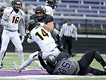 SIOUX FALLS, SD - NOVEMBER 10: Steven McKee #96 and Joey Wehrkamp #45 from the University of South Falls brings down quarterback Alex Thramer #14 from Wayne State during their game Saturday afternoon at Bob Young Field in Sioux Falls. (Photo by Dave Eggen/Inertia)