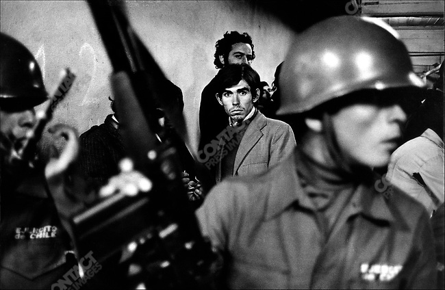 "Daniel Cespedes, a suspected ""leftist"", is taken to the National Stadium after his arrest. In the aftermath of the September 11th Chilean coup, Santiago, Chile, September 1973"
