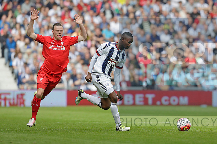 Jonathan Leko of West Bromwich Albion competes with Brad Smith of Liverpool during the Barclays Premier League match at The Hawthorns.  Photo credit should read: Malcolm Couzens/Sportimage