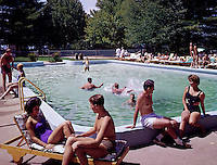 People relaxing by pool