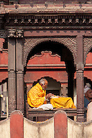 Pashupatinath, Nepal.  Sadhu, a Hindu Ascetic or Holy Man, Reading Sacred Texts in the Temple.
