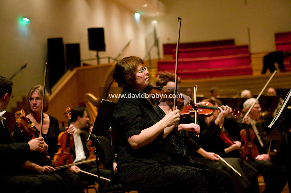 "Members of the Noord Nederlands Orkest prepare to perform ""L'Acte préalable"" by Alexandre Scriabine under the direction of Michel Tabachnik (not pictured) at the salle Pleyel in Paris, France, 9 November 2007."