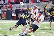 College Park, MD - April 1, 2017: Michigan Wolverines Mikie Schlosser (17) runs pass Maryland Terrapins Curtis Corley (42) during game between Michigan and Maryland at  Capital One Field at Maryland Stadium in College Park, MD.  (Photo by Elliott Brown/Media Images International)